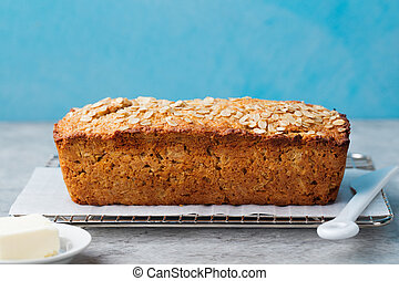 Healthy vegan oat, coconut loaf bread, cake on a cooling rack Copy space