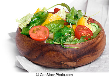 Healthy Vegetable salad in a wooden bowl