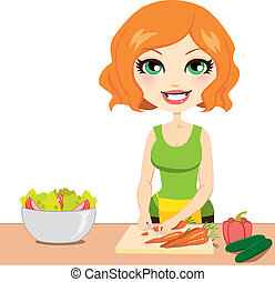Pretty red haired woman preparing healthy nutritious salad cutting vegetables