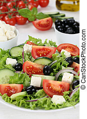 Healthy vegetarian eating Greek salad in bowl with tomatoes,...