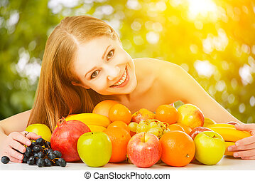 healthy vegetarian food. happy family mother and baby daughter with fruit