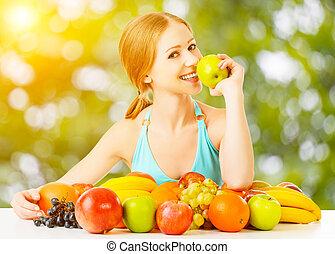 healthy vegetarian food. happy woman eating apple in summer