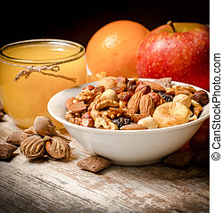 Healthy vegetarian food - organic nuts, orange juice and fruits