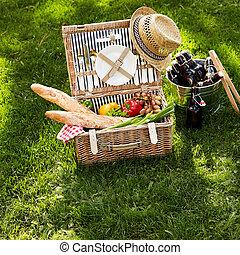 Healthy vegetarian summer picnic hamper with beers