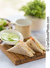 sandwiches stuffed with cucumber, tomato and cheese