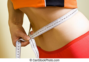 Healthy waistline - Woman measuring her sexy healthy...