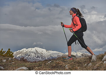 Healthy walk in the mountains during a vacation. A young woman
