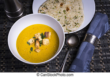 Healthy Warm Soup with Naan Bread - A warming bowl of red...