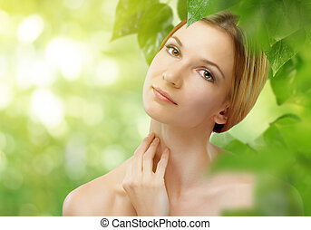 healthy woman - a beauty girl on the leaves background