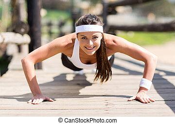 healthy woman doing pushups