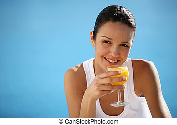 Healthy woman drinking orange juice