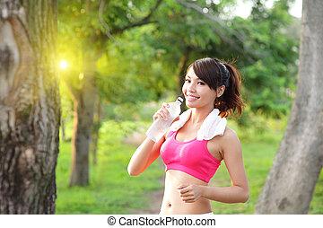 Healthy woman drinks water