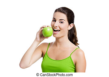 Healthy woman eating an apple