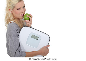 Healthy woman eating apple