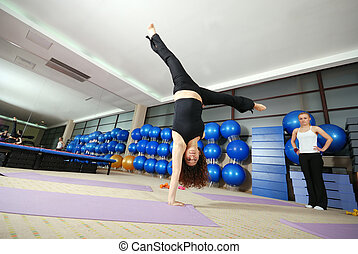 healthy woman exercising in fitness club