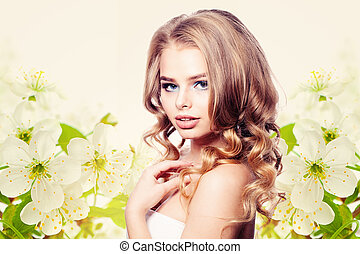 Healthy Woman Fashion Model on Spring Flowers Background
