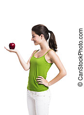 Healthy woman holding an apple