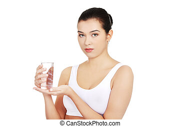 Healthy woman holding glass of water