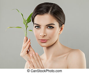 Healthy Woman Holding Green Bamboo Leaves