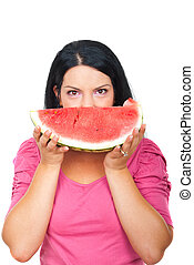 Healthy woman holding water melon