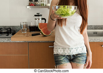 Healthy woman in Kitchen