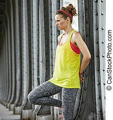 healthy woman looking into distance on Pont de Bir-Hakeim...