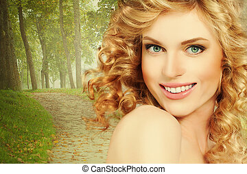 Healthy Woman with Curly Blond Hair on Nature Background Outdoors