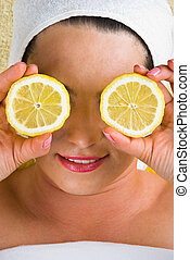 Healthy woman with lemon at spa