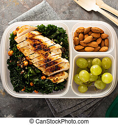 Healthy work or school lunch with grilled chicken, kale and...