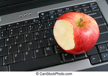 healthy workplace - a business laptop with shiny bitten red...