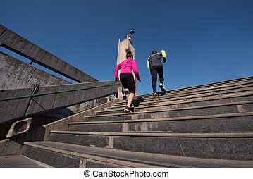 young  couple jogging on steps