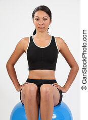Healthy young girl on exercise ball