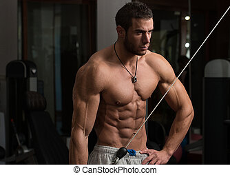 Healthy Young Man Doing Exercise For Triceps