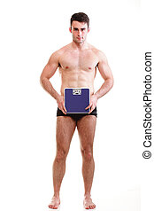 Healthy young man with a weight scale Isolated