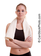 Healthy young woman after sport with towel on shoulder