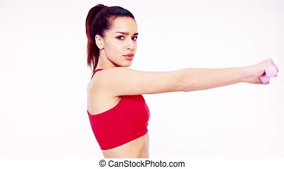 Healthy young woman doing arm exerc