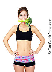 Healthy young woman eating broccoli