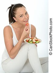 Healthy Young Woman Holding a Plate of Salmon Salad