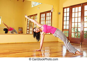 Healthy young woman in gym outfit stretching - Healthy young...