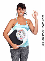 Healthy young woman with scales. - Healthy young woman with...