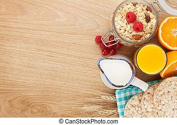 Healty breakfast with muesli, berries and orange juice. View...