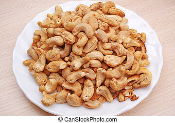 Heap cashew nuts on a white plate