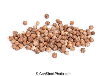 Heap Coriander Seeds (Coriandrum sativum) isolated on white...