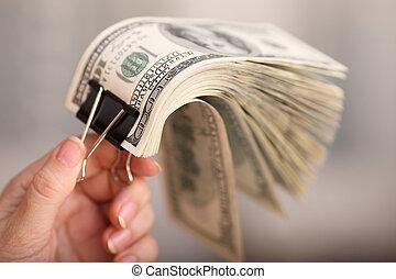 Heap of 100-dollar bills