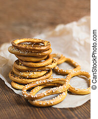 Heap of bagels with sesame seeds on wooden background