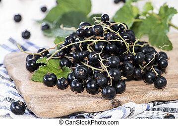 Heap of Black Currants on wooden background