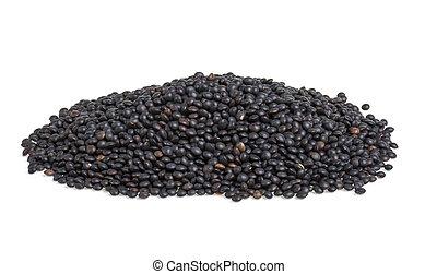 Heap of black lentil isolated on white