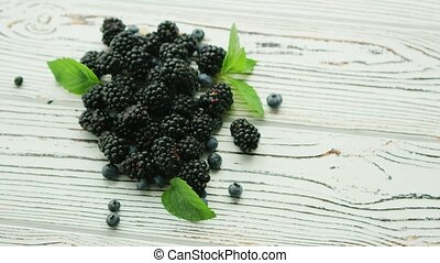Heap of blackberry with mint leaves - From above shot of...