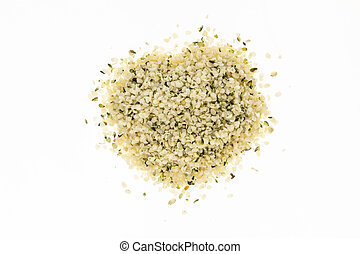 Heap of blanched hemp seeds , on white background