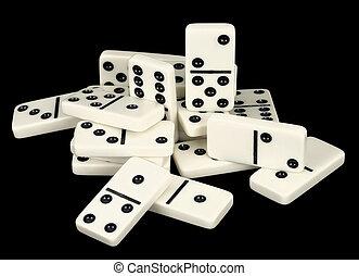 Heap of bones of dominoes on a black